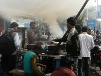 Serving a late breakfast and getting the tandoor fired up for the day, Raja ki Mandi, Agra